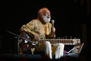 In this Feb. 7, 2012 file photo, Indian musician Ravi Shankar laughs as he speaks during a concert in Bangalore, India. Shankar, the sitar virtuoso who became a hippie musical icon of the 1960s after hobnobbing with the Beatles and who introduced traditional Indian ragas to Western audiences over an eight-decade career, has died. He was 92.