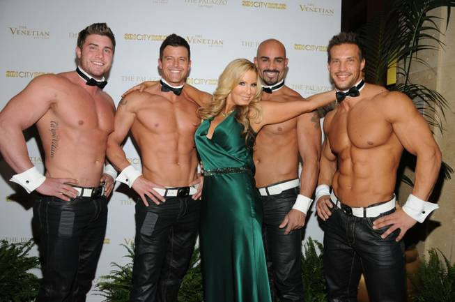 "Alicia Jacobs is flanked by Chippendales dancers Gavin McHale, Nathan Minor, John Rivera and Sami Eskelin at the ""Sin City Rules"" red carpet at the Venetian on Sunday, Dec. 9, 2012."