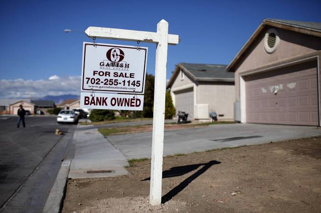 A for sale sign stands outside a bank-owned home in North Las Vegas, Feb. 18, 2009.