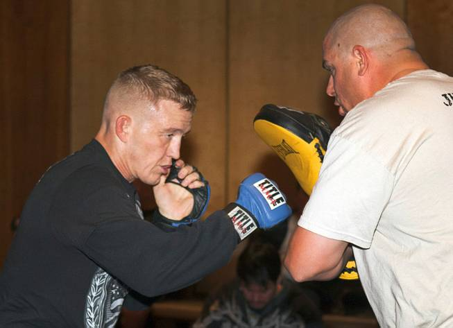 Welterweight fighter Colton Smith, left, works on his timing with Jason Schaefer during UFC Ultimate Fighter Finale workouts at the Hard Rock Thursday, Dec. 13, 2012.