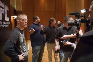 Welterweight fighter Colton Smith, left, talks with reporters during UFC Ultimate Fighter Finale workouts at the Hard Rock Thursday, Dec. 13, 2012.
