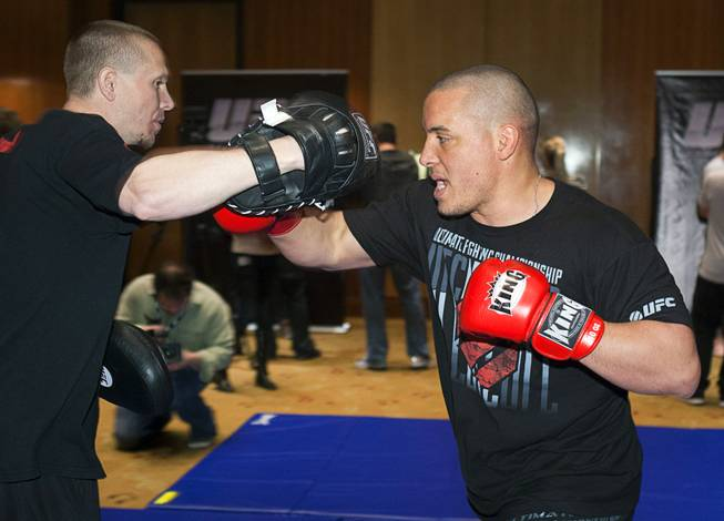 Heavyweight fighter Pat Barry, right, works on his timing with Trevor Wittman during UFC Ultimate Fighter Finale workouts at the Hard Rock Thursday, Dec. 13, 2012.