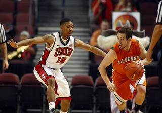 UNLV Rebel Daquan Cook guards Jake Vieth during their game against the La Verne Leopards at the Orleans Arena Thursday, Dec. 13, 2012.