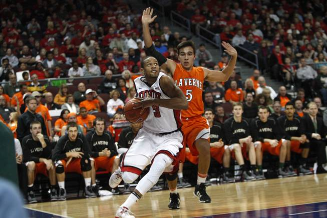 UNLV's Anthony Marshall drives to the basket during UNLV's game against the La Verne Leopards at the Orleans Arena Thursday, Dec. 13, 2012. La Verne's Jourdan Simmonds is at right.