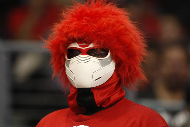 A Rebel fan watches UNLV's game against the La Verne Leopards at the Orleans Arena Thursday, Dec. 13, 2012.
