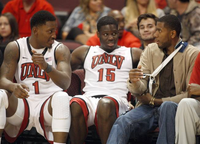 Mike Moser, right, talks with Quintrell Thomas, left, and Anthony Bennett during UNLV's game against the La Verne Leopards at the Orleans Arena Thursday, Dec. 13, 2012.