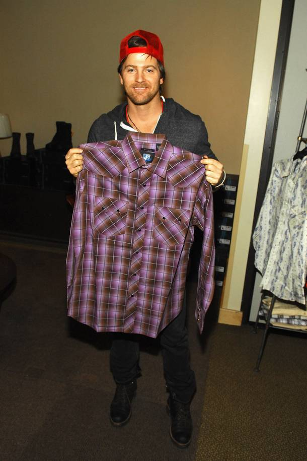 Kip Moore holds a shirt from Resistol.