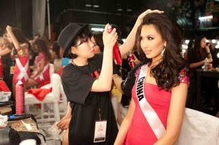 2012 Miss China Ji Dan Xu gets her hair done by CHI stylist Won Jeong Lee backstage at the preliminaries of the 2012 Miss Universe Pageant at Planet Hollywood on Thursday, Dec. 13, 2012.