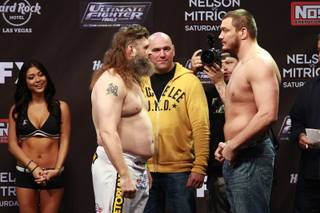 Roy Nelson, left, and Matt Mitrione face off during weigh-ins for the Season 16 finale of