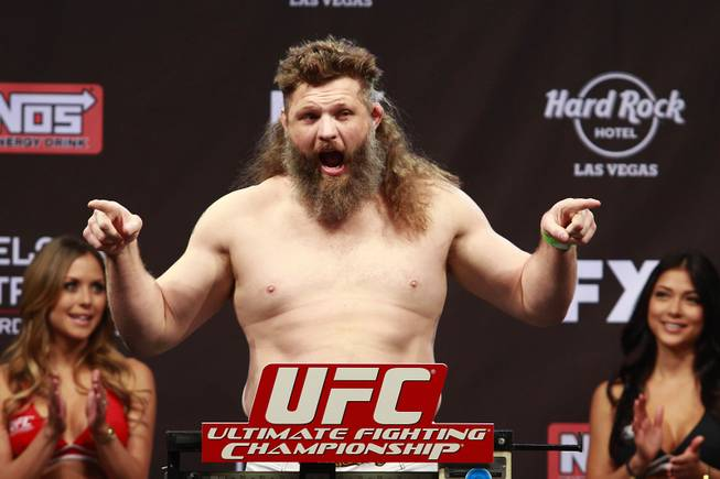 "Roy Nelson points to the crowd during weigh-ins for the Season 16 finale of ""The Ultimate Fighter"" Friday, Dec. 14, 2012, at the Joint in the Hard Rock Hotel."