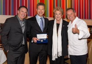 Chef Wolfgang Puck, right, receives a key to Las Vegas from Mayor Carolyn Goodman as his Spago in the Forum Shops at Caesars Palace celebrates its 20th anniversary on Tuesday, Dec. 11, 2012. Also pictured: David Robins and Tom Kaplan.