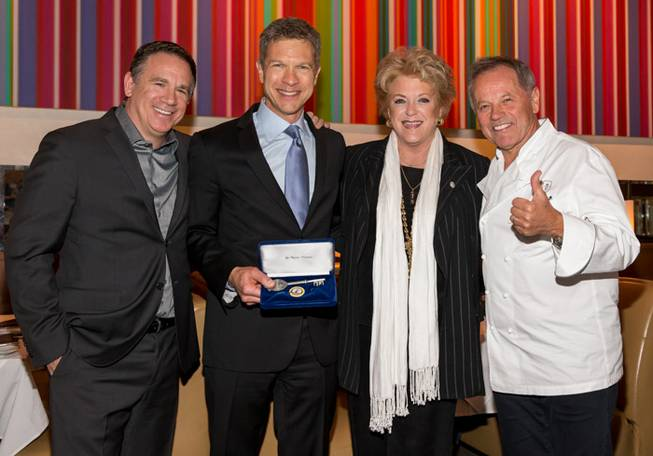 Chef Wolfgang Puck, right, receives a key to Las Vegas ...