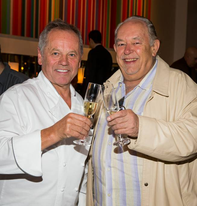 Chef Wolfgang Puck, pictured here with Robin Leach, receives a key to Las Vegas from Mayor Carolyn Goodman as his Spago in the Forum Shops at Caesars Palace celebrates its 20th anniversary on Tuesday, Dec. 11, 2012.
