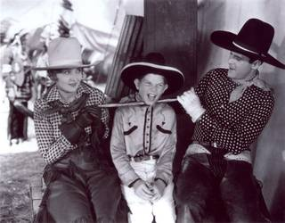 Jack Hanlon, center, in The Wagon Master (1930) with Gladys McConnell and Ken Maynard.