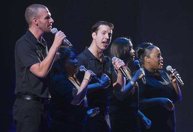 Benjamin Stobber, center, an Aria concierge and other MGM Resorts International employees perform in during a dress rehearsal for Inspiring Our World show at the Mandalay Bay Events Center Saturday, Dec. 15, 2012.