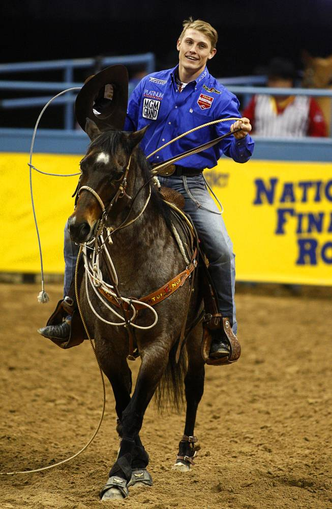 Tuf Cooper, 22, of Decatur, Texas won the world championship title in tie-down roping during the final night of the Wrangler National Finals Rodeo Saturday, Dec. 15, 2012.
