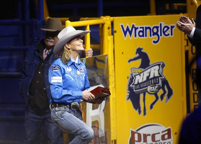 Barrel racer Mary Walker of Ennis, Texas is introduced during the final night of the Wrangler National Finals Rodeo Saturday, Dec. 15, 2012. Walker won the world title and the Ram Truck Top Gun Award, given to the top earner in a single event at the NFR.