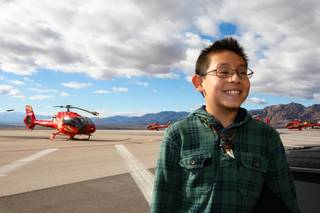 Scholarship recipient Daniel Reyes grins ear to ear after learning he gets to fly on a Papillon helicopter to greet his classmates from Mountain View Christian School at Eldorado Canyon Mine as part of the In12Days 'Ten Lords A-Leaping' celebration at the Boulder City Municipal Airport Saturday, December 15, 2012.