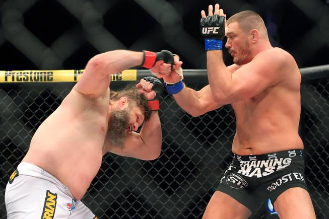 "Roy Nelson and Mike Mitrione trade punches during their bout at ""The Ultimate Fighter 16"" Saturday, Dec. 15, 2012, at the Joint in the Hard Rock Hotel. Nelson won by knockout."