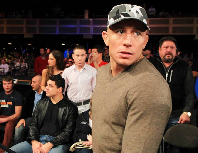 "Georges St. Pierre heads to his seat at ""The Ultimate Fighter 16"" Saturday, Dec. 15, 2012, at the Joint in the Hard Rock Hotel. It was announced that St. Pierre's next fight would be against Nick Diaz."