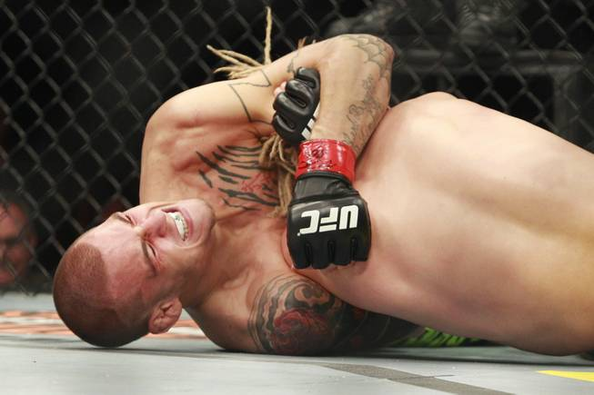 "Dustin Poirier submits Jonathan Brookins with a choke during their bout at ""The Ultimate Fighter 16"" Saturday, Dec. 15, 2012, at the Joint in the Hard Rock Hotel."