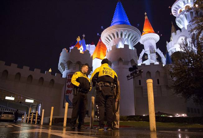 Metro Police officers stand watch outside the entrance to the Excalibur hotel-casino after a shooting near the registration desk left two dead, Friday, Dec. 14, 2012, in Las Vegas.