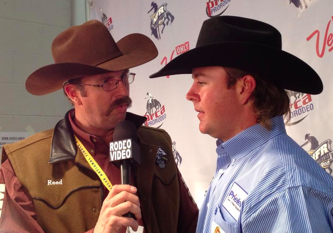 Jade Corkhill talks to the media Saturday night after being named world champion heeler in team roping at the Wrangler National Finals Rodeo in Las Vegas.