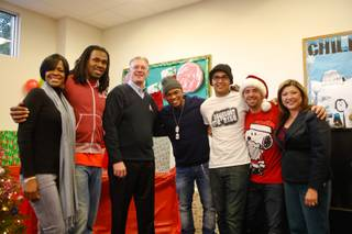 From left, Loraine Smith, Steven Jackson of the St. Louis Rams, Henderson Mayor Andy Hafen, singer-songwriter Ne-Yo, Danny Mendoza, Ken Rubeli (CEO of the Boys & Girls Club of Henderson) and Henderson Councilwoman Gerri Schroder at the sixth annual Compound Foundation Giving Tour stop on Monday, Dec. 17, 2012.