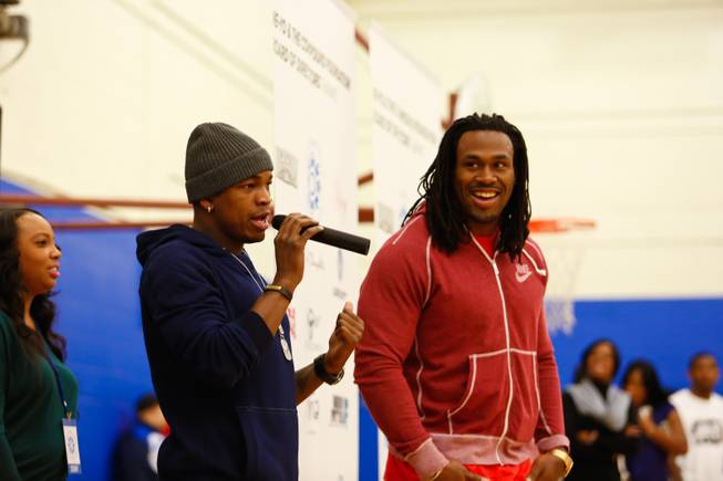 Singer-songwriter Ne-Yo and Steven Jackson of the St. Louis Rams speak to children at the Boys & Girls Club of Henderson during the sixth annual Compound Foundation Giving Tour stop on Monday, Dec. 17, 2012.