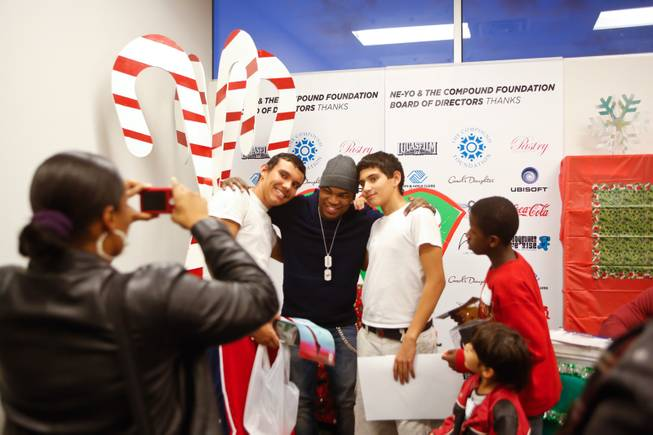 Singer-songwriter Ne-Yo, a Las Vegas native, signs autographs and talks to kids at the Boys & Girls Club of Henderson during the sixth annual Compound Foundation Giving Tour stop on Monday, Dec. 17, 2012.