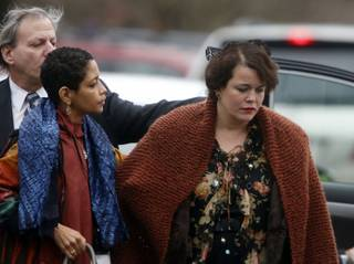 Veronika Pozner, right, arrives at a funeral service for her son, 6-year-old Noah Pozner, Monday, Dec. 17, 2012, in Fairfield, Conn. Pozner was killed when Adam Lanza walked into Sandy Hook Elementary School in Newtown on Friday and opened fire, killing 26 people, including 20 children.