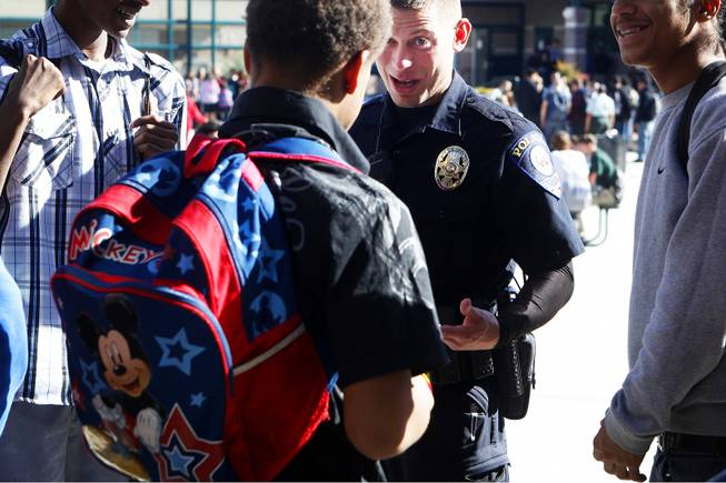 In this November 2011 file photo, Clark County School District Police officer John Maier talks with students during lunch at Mojave High School in North Las Vegas. CCSD and Metro Police say they'll continue an increased police presence in and around Clark County schools in the wake of last week's shootings at Sandy Hook Elementary School in Newtown, Conn.