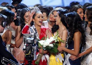 Miss USA Olivia Culpo, center, is surrounded by other contestants after being crowned Miss Universe during the 2012 Miss Universe Pageant at Planet Hollywood on Wednesday, Dec. 19, 2012.