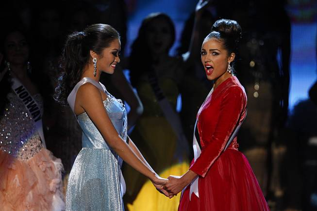 Miss USA Olivia Culpo, right, reacts with Miss Philippines Janine Tugonon after being named Miss Universe during the 2012 Miss Universe Pageant at Planet Hollywood on Wednesday, Dec. 19, 2012. Tugonon was first runner-up.
