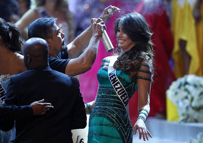 A stylist tends to the hair of Miss Venezuela Irene Esser during a commercial break in the 2012 Miss Universe Pageant at Planet Hollywood on Wednesday, Dec. 19, 2012. Esser was second runner-up.