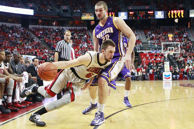 UNLV guard Katin Reinhardt drives past UNI forward Jake Koch during their game Wednesday, Dec. 19, 2012 at the Thomas & Mack. UNLV won 73-59 to push their record to 10-1.