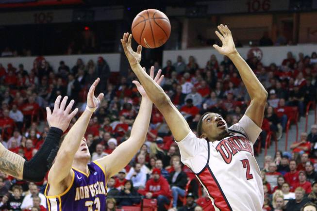 UNLV forward Khem Birch grabs a rebound from UNI center Austin Pehl during their game Wednesday, Dec. 19, 2012 at the Thomas & Mack. UNLV won 73-59 to push their record to 10-1.