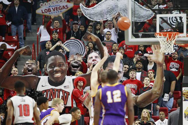"The UNLV student section ""The Rebellion"" tries to distract a UNI free throw shooter during their game Wednesday, Dec. 19, 2012 at the Thomas & Mack. UNLV won 73-59 to push their record to 10-1."