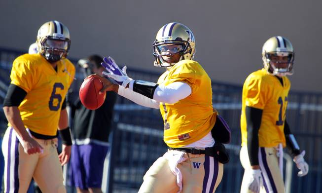 Washington quarterback Keith Price practices with his team at Bishop Gorman High School in Las Vegas on Wednesday, December 19, 2012. Washington is preparing to face Boise State in Saturday's Maaco Bowl Las Vegas