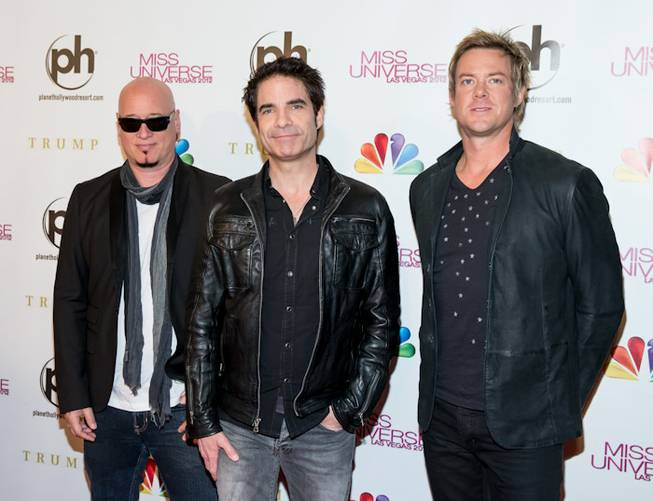 Jimmy Stafford, Pat Monahan and Scott Underwood of Train arrive ...