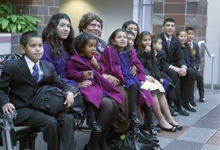 Maciel children sit with their grandmother Daisy at family court Thursday, Dec. 20, 2012. The family officially adopted four more children for a total of eleven children.