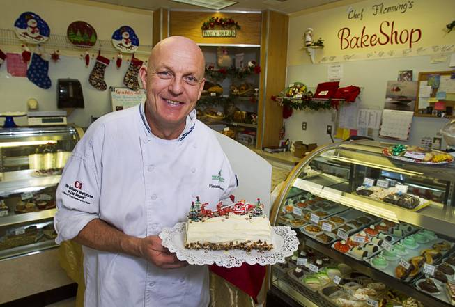 Chef Flemming Pedersen poses with a yule log at Chef Flemmings Bake Shop, a European-style bakery, on Water Street in downtown Henderson Thursday, Dec. 20, 2012.