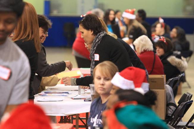 "People line up to receive a gift card worth $500, thanks to the largess of an anonymous ""Secret Santa"" who donated $1 million for families in southern Nevada Thursday, Dec. 20, 2012."
