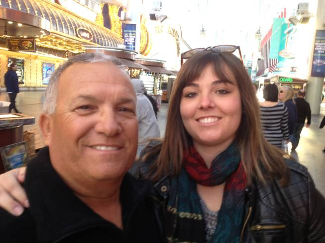 Steve Staley (left) and his daughter Ashley were interviewed about the supposed Mayan Apocalypse on Dec. 20, 2012, on Fremont Street in downtown Las Vegas.