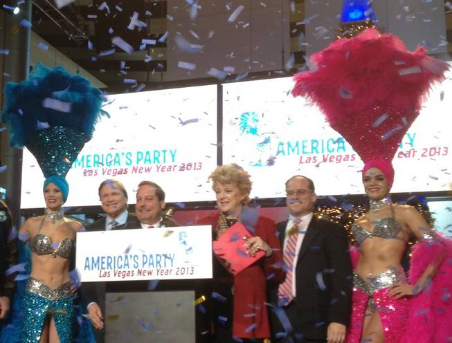 Las Vegas Mayor Carolyn Goodman is flanked by civic leaders and show girls during a press conference Dec. 20, 2012, at Fashion Show Mall to announce plans for New Year's Eve fireworks.