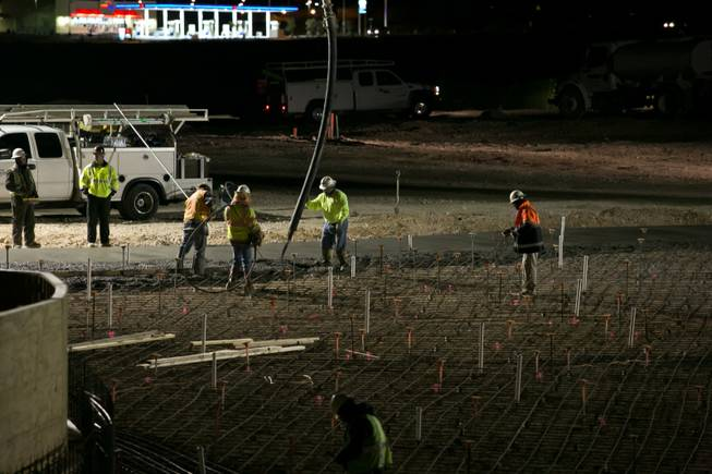 Construction workers manage the concrete pour as it's laid onto the site of the 17,000-square-foot wave pool at Las Vegas' newest attraction Wet 'n' Wild, a 41-acre water park expected to open in Spring of 2013, Thursday, Dec. 20, 2012.