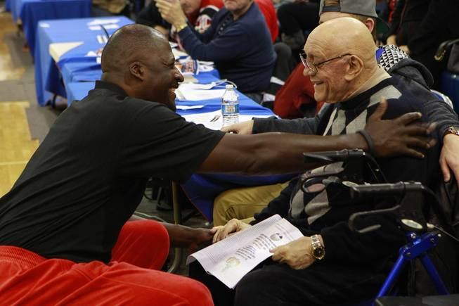 Former NBA player Michael Cage talks with Jerry Tarkanian between games in the inaugural Jerry Tarkanian Classic Thursday, Dec. 20, 2012.