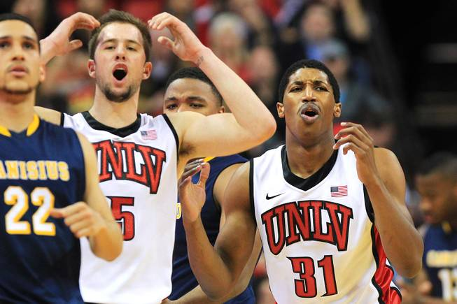 UNLV guards Katin Reinhardt, left, and Justin Hawkins react after getting called for a foul during their game against Canisius Saturday, Dec. 22, 2012 at the Thomas & Mack. The Runnin' Rebels won 89-74.