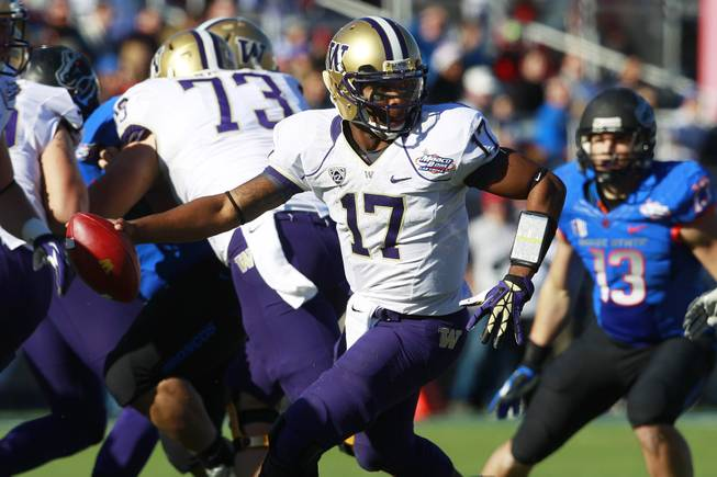 Washington quarterback Keith Price rolls out during the 2012 Maaco Bowl Las Vegas game against Boise State Saturday, Dec. 22, 2012 at Sam Boyd Stadium. Boise State won their third consecutive Vegas Bowl 28-26.