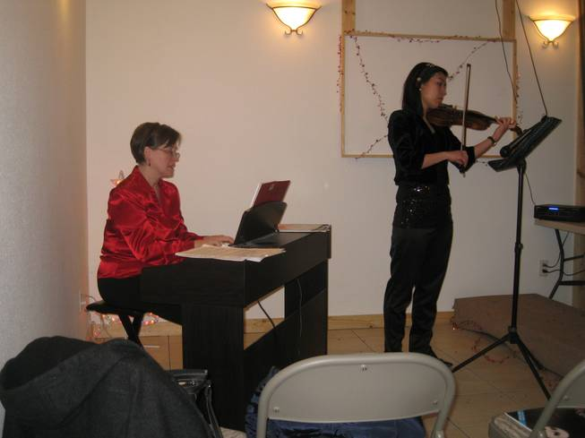 "Pocatello music instructor and pianist Laura Larson and violinist Keum Hwa Cha of the Idaho State Civic Symphony in Pocatello, Idaho perform ""Silent Night"" during the holiday party at Lava Hot Springs Inn on December 20, 2012."